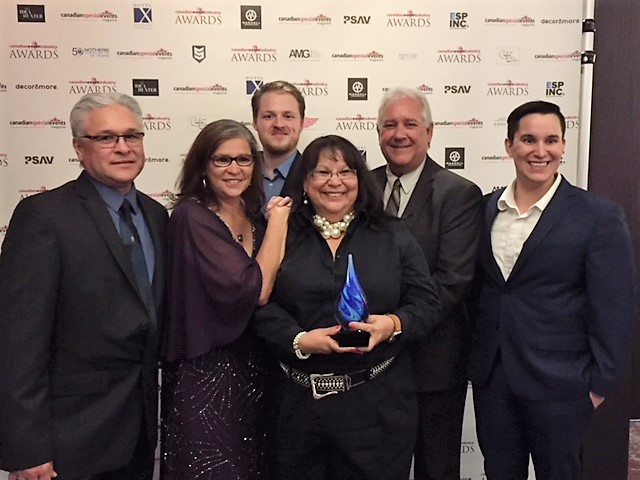 Group of conference organizers holding award